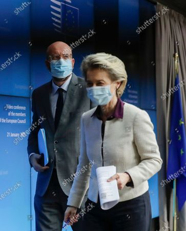 European Council President Charles Michel, left, and European Commission President Ursula von der Leyen leave after a joint news conference at the end of a EU summit video conference at the European Council headquarters in Brussels, . European Union leaders assessed more measures to counter the spread of coronavirus variants during a video summit Thursday as the bloc's top disease control official said urgent action was needed to stave off a new wave of hospitalizations and deaths