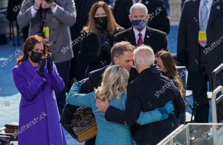 President Joe Biden hugs first lady Jill Biden, his son Hunter Biden and daughter Ashley Biden after being sworn-in during the 59th Presidential Inauguration at the U.S. Capitol in Washington, . Vice President Kamala Harris applauds at left, and Vice President Mike Pence and his wife Karen applaud behind