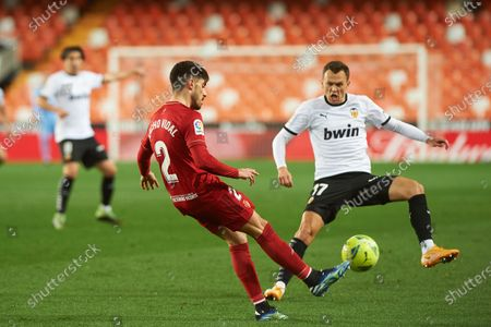 Nacho Vidal of Osasuna  and Denis Cheryshev of Valencia CF during the La Liga Santander mach between Valencia and Osasuna at Estadio de Mestalla on 23 January, 2021 in Valencia, Spain