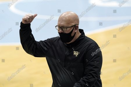 Wake Forest head coach Steve Forbes reacts during the first half of an NCAA college basketball game against North Carolina in Chapel Hill, N.C