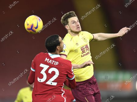 Joel Matip of Liverpool (L) in action against Ashley Barnes of Burnley (R) during the English Premier League soccer match between Liverpool FC and Burnley FC in Liverpool, Britain, 21 January 2021.