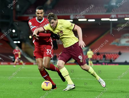 Joel Matip of Liverpool (L) in action against Chris Wood of Burnley (R) during the English Premier League soccer match between Liverpool FC and Burnley FC in Liverpool, Britain, 21 January 2021.