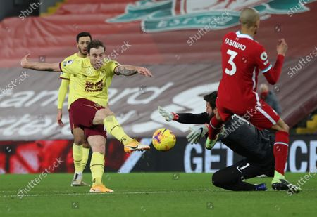 Liverpool's goalkeeper Alisson saves a shot by Burnley's Ashley Barnes, left, during the English Premier League soccer match between Liverpool and Burnley in Liverpool, England