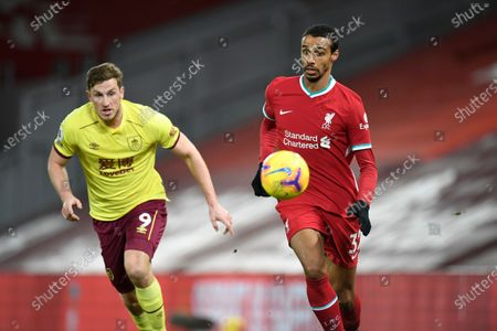 Liverpool's Joel Matip, right, during the English Premier League soccer match between Liverpool and Burnley in Liverpool, England