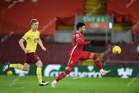 Liverpool's Alex Oxlade-Chamberlain runs to control the ball during the English Premier League soccer match between Liverpool and Burnley in Liverpool, England