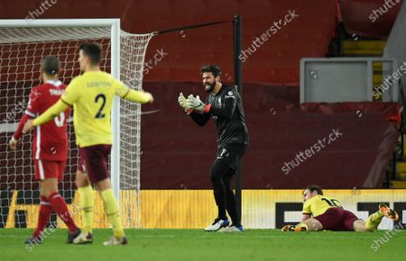 Liverpool's goalkeeper Alisson, center, reacts after giving out a penalty to Burnley's Ashley Barnes, right, during the English Premier League soccer match between Liverpool and Burnley in Liverpool, England