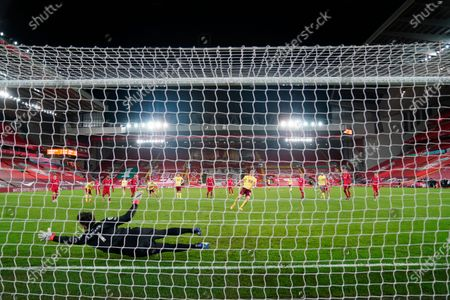 Liverpool's goalkeeper Alisson tries to stop Burnley's Ashley Barnes' penalty kick during the English Premier League soccer match between Liverpool and Burnley in Liverpool, England, . Barnes scored and Burnley won the match 0-1