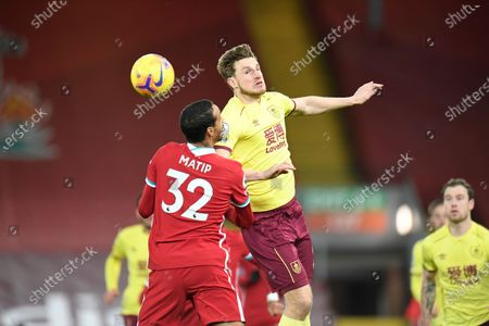 Burnley's Chris Wood, right, fights for the ball with Liverpool's Joel Matip, left during the English Premier League soccer match between Liverpool and Burnley in Liverpool, England