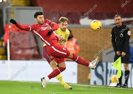 Liverpool's Alex Oxlade-Chamberlain, left fights for the ball with Burnley's Charlie Taylor during the English Premier League soccer match between Liverpool and Burnley in Liverpool, England