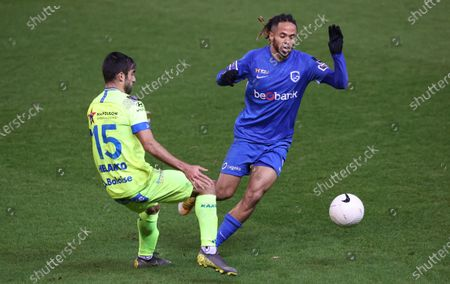 Gent's Milad Mohammadi and Genk's Theo Bongonda fight for the ball during a soccer match between KRC Genk and KAA Gent, Thursday 21 January 2021 in Genk, on the advanced day 25 of the 'Jupiler Pro League' first division of the Belgian championship.