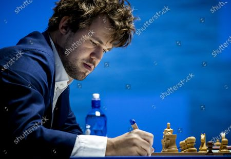 Magnus Carlsen of Norway during his fifth round match at the international chess tournament TataSteel Chess Tournament 2021, in Wijk aan Zee, the Netherlands, 21 January 2021. Due to coronavirus pandemic restrictions, the tournament is held without amateur chess players nor audience.