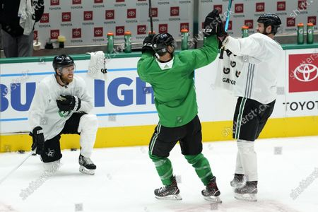 Stock Photo of Dallas Stars' Joe Pavelski (16) laughs as Taylor Fedun (42) and Jamie Benn, right, celebrate after their squad won a shoot-out drill during NHL hockey practice in Dallas