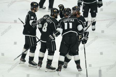 Los Angeles Kings celebrate a goal by defenseman Drew Doughty (8) during the second period of an NHL hockey game against the Colorado Avalanche, in Los Angeles