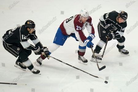 Los Angeles Kings center Trevor Moore (12) and center Blake Lizotte (46) defend against Colorado Avalanche center Nathan MacKinnon (29) during the second period of an NHL hockey game, in Los Angeles