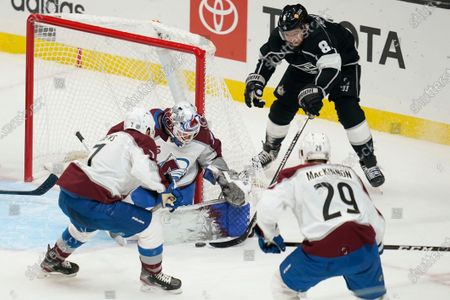 Colorado Avalanche goaltender Hunter Miska blocks a shot by Los Angeles Kings defenseman Drew Doughty (8) during the second period of an NHL hockey game, in Los Angeles