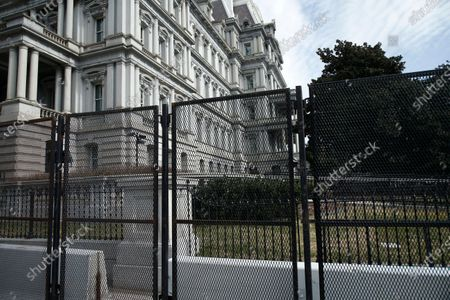 Stock Picture of A non scalable fence surrounds the perimeter of the Dwight D. Eisenhower Executive Building near the White House.   According to news sources neither the FBI nor Homeland Security made an announcement regarding lowering the present security level around the US Capitol and downtown Washington DC.