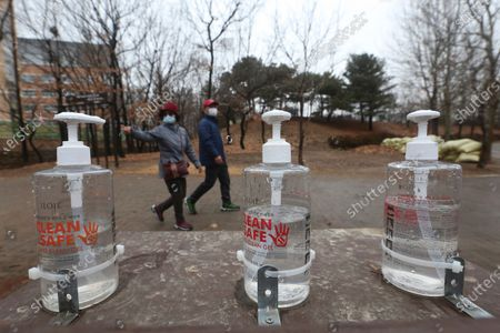 Bottles of hand sanitizer are displayed for use at a park in Goyang, South Korea, . South Korea is reporting its smallest daily increase in coronavirus infections in two months as officials express cautious hope that the country is beginning to wiggle out from its worst wave of the pandemic