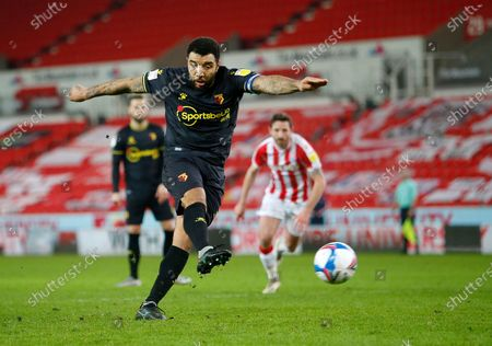 Troy Deeney of Watford  scores thew first goal from the penalty spot