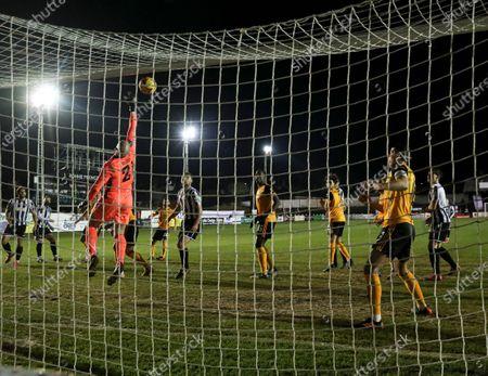 Wolverhampton Wanderers goalkeeper John Ruddy makes a save from Andy Halls of Chorley