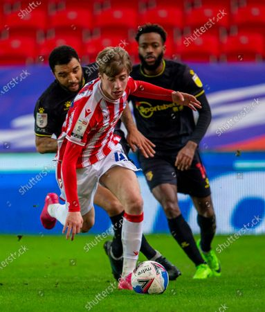 Jack Clarke of Stoke City under pressure from Troy Deeney of Watford; Bet365 Stadium, Stoke, Staffordshire, England; English Football League Championship Football, Stoke City versus Watford.