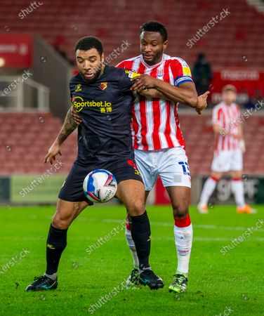 Troy Deeney of Watford under pressure from John Obi Mikel of Stoke City; Bet365 Stadium, Stoke, Staffordshire, England; English Football League Championship Football, Stoke City versus Watford.