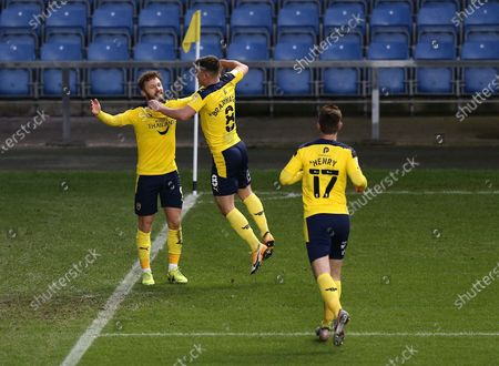 Stock Image of Matty Taylor of Oxford United  scores his sides second goal past Joe Day of Bristol Rovers  with team-mate Cameron Brannagan