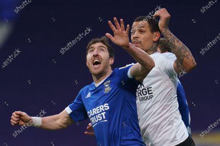 Stephen Ward of Ipswich Town (3) and Jonson Clarke-Harris of Peterborough United (9)