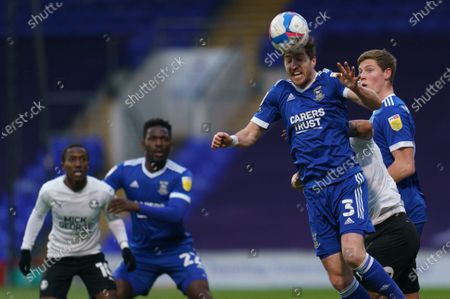 Stephen Ward of Ipswich Town (3) heads the ball