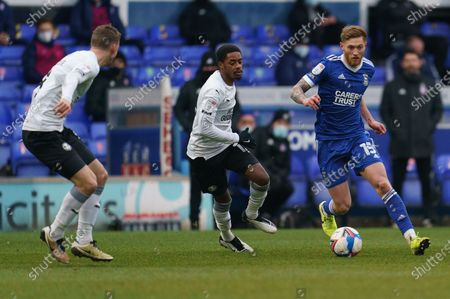 Teddy Bishop of Ipswich Town (15) runs past Reece Brown of Peterborough United (12)