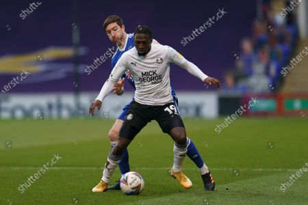 Stephen Ward of Ipswich Town (3) and Idris Kanu of Peterborough United (19)