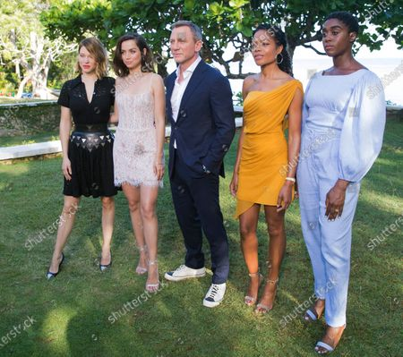 Actors from left, Lea Seydoux, Ana de Armas, Daniel Craig, Naomie Harris and Lashana Lynch pose for photographers during the photo call of the latest installment of the James Bond film franchise, in Oracabessa, Jamaica. Producers of the forthcoming James Bond thriller say the film's release has been delayed again, until the fall of 2021, because of the effects of the coronavirus pandemic. The official 007 Twitter account said late Thursday, Jan. 21, 2021 that the 25th installment in the franchise will now open on Oct. 8