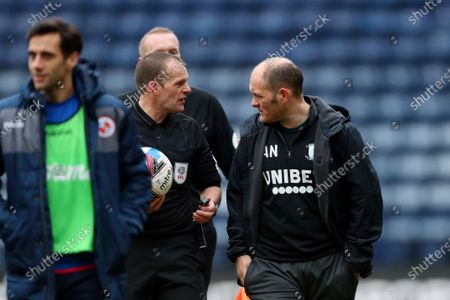Preston North End manager Alex Neil speaks with Referee Geoff Eltringham at the end of the match