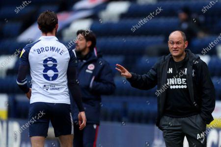 Preston North End manager Alex Neil speaks with Alan Browne