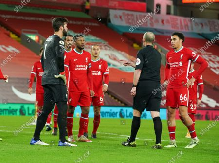 Alisson Becker of Liverpool and team mates after Referee Mike Dean awards burnley a penalty