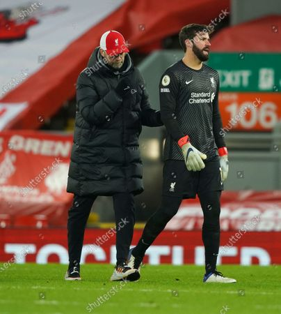 Alisson Becker of Liverpool is sconsoled by Manager Jugen Klopp at end of the match