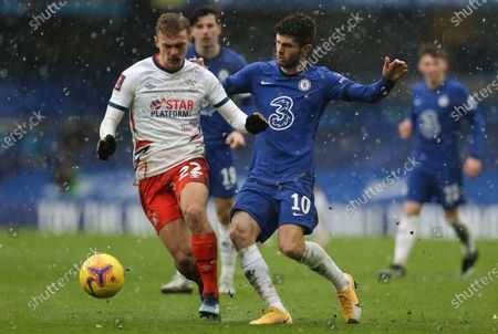 Kiernan Dewsbury-Hall of Luton Town and Christian Pulisic of Chelsea  in action