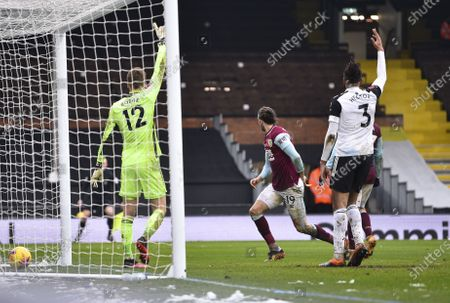 Marek Rodák of Fulham and Michael Hector of Fulham appeal for offside after Jay Rodriguez of Burnley opens the scoring