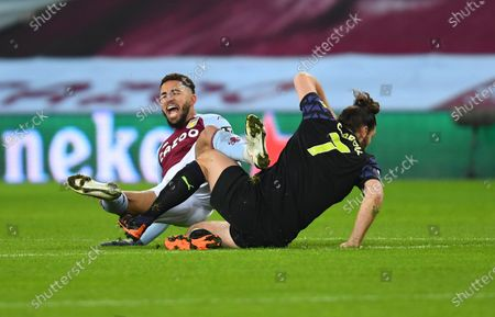 Douglas Luiz of Aston Villa is tackled by Andy Carroll of Newcastle United