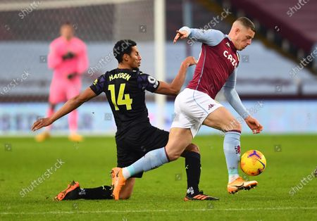 Ross Barkley of Aston Villa is tackled by Isaac Hayden of Newcastle United