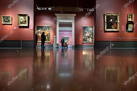 "Visitors enter a hall to see the collection of the Pushkin State Museum of Fine Arts in Moscow, Russia, . Moscow Mayor Sergei Sobyanin earlier this week eased some of the coronavirus restrictions in the Russian capital, citing ""cautious optimism"" about the course of the outbreak. Among other things, Sobyanin allowed museums to reopen"