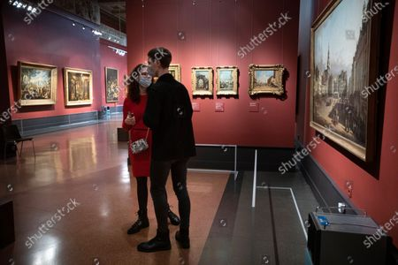 "Visitors look the collection of the Pushkin State Museum of Fine Arts in Moscow, Russia, . Moscow Mayor Sergei Sobyanin earlier this week eased some of the coronavirus restrictions in the Russian capital, citing ""cautious optimism"" about the course of the outbreak. Among other things, Sobyanin allowed museums to reopen"