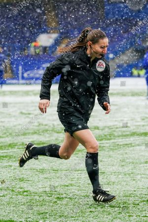 Assistant Referee Sian Massey-Ellis warms up in the heavy snow before kick off