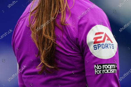 Detail of the 'No room for racism' patch on the assistant referee shirt of Sian Massey-Ellis