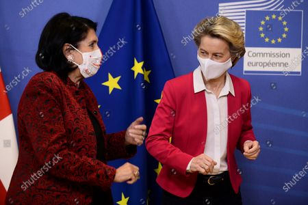 Stock Picture of Georgia's President Salome Zourabichvili, left, is welcomed by European Commission President Ursula von der Leyen before their meeting at the European Commission headquarters in Brussels