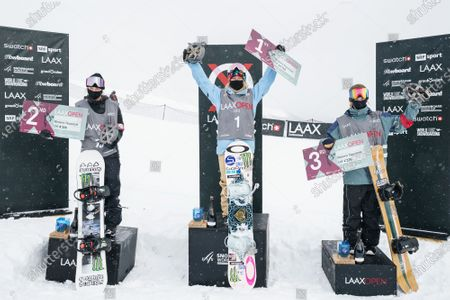 Stock Image of (L-R) second placed Zoi Sadowski Synnott from New Zealand, winner Jamie Anderson from the USA and third placed Tess Coady from Australia celebrate on the podium for the Men's Slopestyle final at the FIS Snowboard World Cup competition Laax Open in Laax, Switzerland, 22 January 2021.