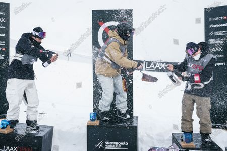 (L-R) second placed Zoi Sadowski Synnott from New Zealand, winner Jamie Anderson from the USA and third placed Tess Coady from Australia celebrate on the podium for the Men's Slopestyle final at the FIS Snowboard World Cup competition Laax Open in Laax, Switzerland, 22 January 2021.