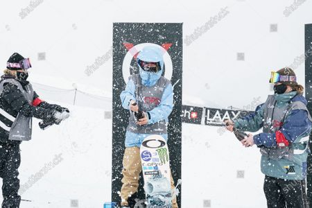 (L-R) second placed Zoi Sadowski Synnott from New Zealand, winner Jamie Anderson from the USA and third placed Tess Coady from Australia celebrate on the podium for the Women's Slopestyle final at the FIS Snowboard World Cup competition Laax Open in Laax, Switzerland, 22 January 2021.