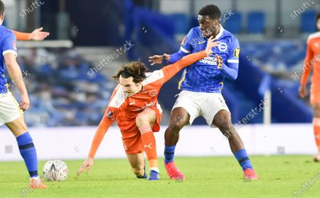 Michael Jordan Williams of Blackpool tries to hold off Yves Bissouma of Brighton during the Emirates FA Cup Fourth Round  match between Brighton and Hove Albion and Blackpool Town at the American Express Stadium  , Brighton , UK - 23rd January 2021
