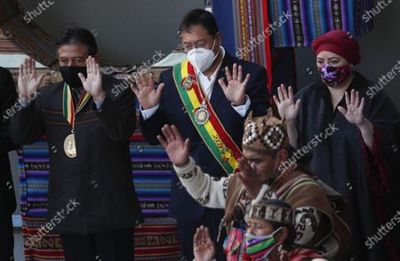 """Bolivia's President Luis Arce, center, Vice President David Choquehuanca, left, and lead Minister Maria Nela Prada, right, attend a ceremony in honor of the """"Pachamama,"""" or Mother Earth, outside of the presidential palace where Arce gave his annual address to the nation in La Paz, Bolivia, . The message marked the anniversary of the naming of Bolivia as the """"Plurinational State of Bolivia,"""" by former President Evo Morales"""