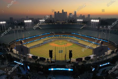 Stock Photo of Los Angeles, California-Jan. 8, 2021-Dodger Stadium is lite up tonight in honor of the passing of Hall of Fame Los Angeles Dodger manager Tommy Lasorda, who passed away at the age of 93. (Carolyn Cole / Los Angeles Times)